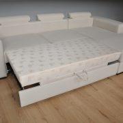 CASTELLO Caya Design Warszawa Studio Komfort narożnik z funkcją spania i pojemnikiem funkcja spania bez poduch